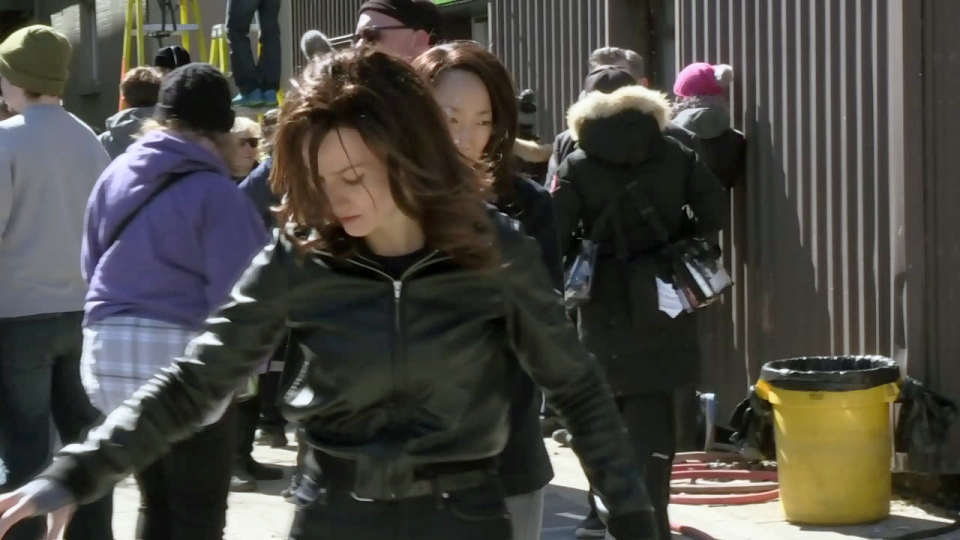 Two actresses rehearse a fight scene during filming of Designated Survivor in Cambridge.