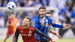 Toronto FC forward Eriq Zavaleta (15) and Montreal Impact midfielder Ignacio Piatti (10) go after the ball during second half MLS action in Montreal on Saturday, March 17, 2018. THE CANADIAN PRESS/Ryan Remiorz