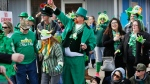 People line the streets of Norfolk, Va., Ocean View community to watch the 51st annual Ocean View St. Patrick's Day Parade on Saturday, March 17, 2018. (Stephen M. Katz/The Virginian-Pilot via AP)