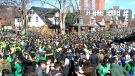 Thousands of party-goers flood Ezra Ave. in Waterloo, Ont. on Saturday, March 17, 2018.