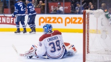 Montreal Canadiens goaltender Charlie Lindgren sits on the ice after Toronto Maple Leafs Kasperi Kapanen scored a subsequently disallowed goal during second period NHL hockey action in Toronto, on Saturday, March 17, 2018.THE CANADIAN PRESS/Chris Young