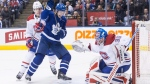 Montreal Canadiens goaltender Charlie Lindgren (right) makes a stop in front of Toronto Maple Leafs Zach Hyman (centre) as Canadiens Mike Reilly closes in during second period NHL hockey action in Toronto on Saturday, March 17 , 2018.THE CANADIAN PRESS/Chris Young