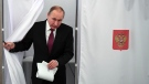 Russian President and Presidential candidate Vladimir Putin exits a polling booth as he prepares to cast his ballot during Russia's presidential election in Moscow, Russia, Sunday, March 18, 2018.  (Yuri Kadobnov/Pool Photo via AP)