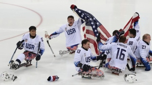 United States players celebrate after defeating Canada in the Ice Hockey gold medal match for the 2018 Winter Paralympics at the Gangneung Hockey Center in Gangneung, South Korea, Sunday, March 18, 2018. (AP Photo/Ng Han Guan)