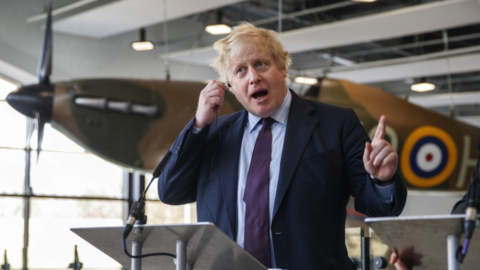 In this Friday, March 16, 2018 file photo, Britain's Foreign Secretary Boris Johnson speaks at a joint press conference with the Polish Foreign Minister Jacek Czaputowicz during a visit to the Battle of Britain Bunker, in Uxbridge, England. (Tolga Akmen/Pool Photo via AP)