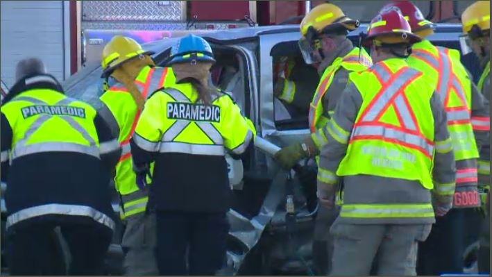 Crews worked to free a trapped driver after a two-vehicle crash in Waterloo. March 17, 2018.