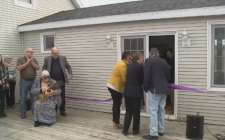 A ceremonial ribbon cutting officially opens the 'Hope Project', a live-in recovery home for women who have substance abuse issues.