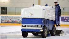 Months after an ammonia leak killed three men at an ice rink in southeastern British Columbia, some industry experts are raising concerns about the staffing and inspections of arenas using the hazardous gas. A Zamboni cleans the ice surface at a rink in Oakville, Ont., Dec.7, 2017. (THE CANADIAN PRESS)