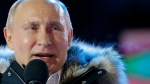 Russian President Vladimir Putin speaks to supporters during a rally near the Kremlin in Moscow, Sunday, March 18, 2018. An exit poll suggests that Vladimir Putin has handily won a fourth term as Russia's president, adding six more years in the Kremlin for the man who has led the world's largest country for all of the 21st century. (AP Photo/Alexander Zemlianichenko)