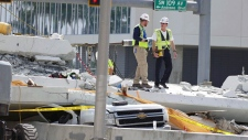 "Inspectors walks over what remains of a pedestrian bridge near Florida International University, Sunday, March 18, 2018 near Miami. As crews removed bodies from beneath a collapsed pedestrian bridge Saturday, a victim's uncle raged against what he called the ""complete incompetence"" and ""colossal failure"" that allowed people to drive beneath the unfinished concrete span. The unfinished bridge collapsed on Thursday killing six people. (C.M. Guerrero/The Miami Herald via AP)"