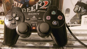 A controller for the Sony Playstation 2 is shown with games at Best Buy in San Francisco on Monday, March 28, 2005. (AP Photo/Jeff Chiu)