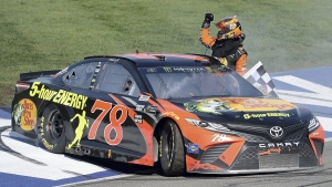Martin Truex Jr. celebrates after winning the NASCAR 400 mile auto race on March 18, 2018, at Auto Club Speedway in Fontana, Calif. (Will Lester / AP)