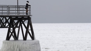 Michele King, 26, looks out over frozen Lake Erie in Cleveland, on Jan. 3, 2018. (Tony Dejak / AP)