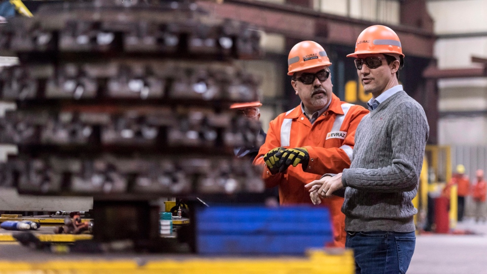 Prime Minister Justin Trudeau, right, and Scott Manson, director of operations, center right, tour EVRAZ Regina, a steel company in Regina, Saskatchewan on Wednesday March 14, 2018. THE CANADIAN PRESS/Michael Bell