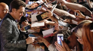 Jim Carrey signs autographs at the Venice Film Festival, on Sept. 5, 2017. (Domenico Stinellis / AP)
