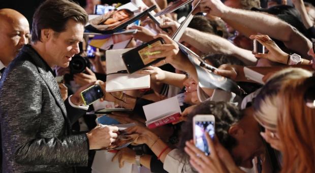 Jim Carrey signs autographs at the Venice Film Festival, on Sept. 5, 2017. (Domenico Stinellis / AP)