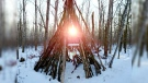 Sun peeking thru the teepee on Paradise Village walking trails at Ste. Anne. Photo by Frank Leys.