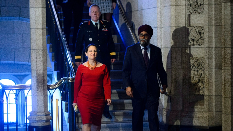 Minister of National Defence Minister Harjit Sajjan, Minister of Foreign Affairs Chrystia Freeland and Chief of Defence Staff Jonathan Vance arrive to take part in a press conference on Canada's peacekeeping mission to Mali in the foyer of the House of Commons on Parliament Hill in Ottawa Monday, March 19, 2018. THE CANADIAN PRESS/Sean Kilpatrick