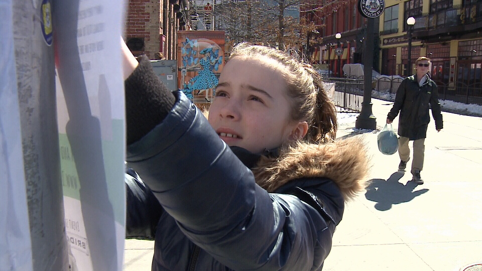 11-year-old Grace Brosha with poster for 100 Kids.