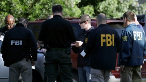 FBI agents work at a scene near the site of Sunday's explosion, Monday, March 19, 2018, in Austin, Texas. (AP Photo/Eric Gay)