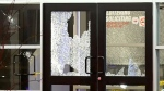 The shattered window panes at a North York bowling alley where two people were shot and killed.