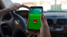 "In this Wednesday, July 20, 2016 photo, Egyptian dentist Mark Shehata, 24, uses the ""Pokemon Go"" mobile phone application while driving in Cairo, Egypt. (Amr Nabil/AP Photo)"