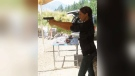 This 2009 photo shows soon-to-be duchess Meghan Markle holding a gun at a range in Pitt Meadows. (The Sun)