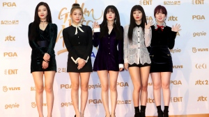 In this Jan. 10, 2018, photo, South Korean popular girl band Red Velvet poses for photographers during the 32nd Golden Disc Awards in Goyang, South Korea. (Lim Tae-hoon/Newsis via AP)