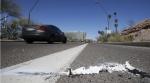 A vehicle at the location where a pedestrian was stuck by an Uber vehicle in autonomous mode, in Tempe, Ariz., on March 19, 2018. (Chris Carlson / AP)