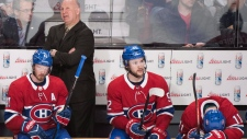 Montreal Canadiens head coach Claude Julien looks on from the bench with left wing Paul Byron (41), centre Jonathan Drouin (92), and right wing Brendan Gallagher (11) during third period NHL hockey action against the Florida Panthers in Montreal, Monday, March 19, 2018. THE CANADIAN PRESS/Graham Hughes
