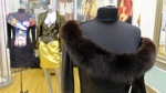 A dress with a fox fur collar is displayed in the basement of West Coast Leathers in San Francisco, on March 15, 2018. (Eric Risberg / AP)