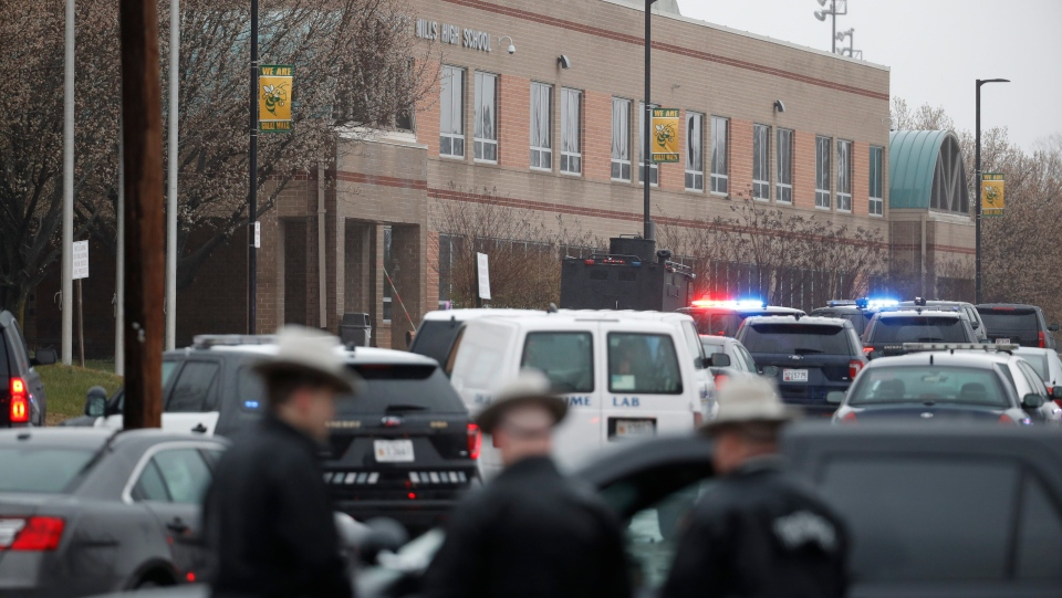 Deputies and federal agents converge on Great Mills High School, the scene of a shooting, Tuesday morning, March 20, 2018 in Great Mills, Md. (AP Photo/Alex Brandon)