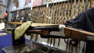 A Ottawa hunting store salesperson wipes a shotgun on Tuesday, May 16, 2006. THE CANADIAN PRESS/Jonathan Hayward