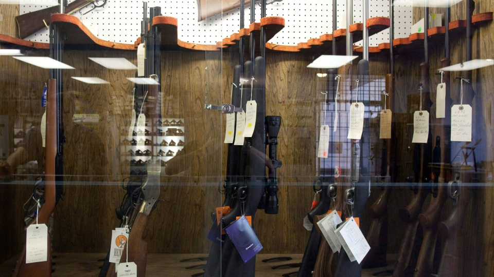 Hunting rifles are seen on display in a glass case at a gun and rifle store in downtown Vancouver, Wednesday, Sept. 15, 2010. THE CANADIAN PRESS/Jonathan Hayward
