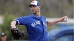 Toronto Blue Jays' J.A. Happ pitches in a spring baseball exhibition game in Dunedin, Fla., on March 12, 2018. (John Raoux / AP)
