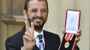 Musician Ringo Starr, poses for photographers after being awarded a knighthood, during an Investiture ceremony at Buckingham Palace, in London on Tuesday March 20, 2018. (John Stillwell/Pool Photo via AP)