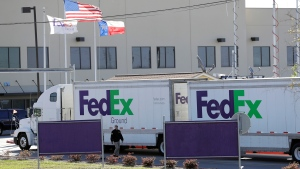An FBI agent investigates at a FedEx distribution center where a package exploded, Tuesday, March 20, 2018, in Schertz, Texas. (AP / Eric Gay)