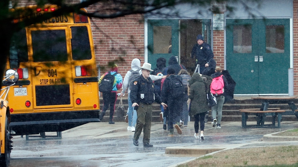 Police move students into a different area of Great Mills High School, the scene of a shooting, Tuesday morning, March 20, 2018 in Great Mills, Md. (AP / Alex Brandon)