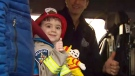 Five-year-old Matteo Papa gives the camera a thumbs up before heading off to school in a firetruck as a birthday present from Vaughan Fire Services.