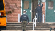 A policeman gives a thumbs-up after moving students into a different area of Great Mills High School, the scene of a shooting, Tuesday morning, March 20, 2018 in Great Mills, Md. (AP Photo/Alex Brandon )