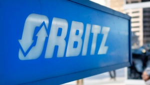 This Feb. 12, 2015 file photo shows signage for travel booking site Orbitz outside the building that houses its headquarters, in Chicago. (AP Photo/Kiichiro Sato)