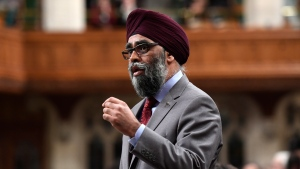 Minister of National Defence Harjit Sajjan rises during Question Period in the House of Commons on Parliament Hill in Ottawa on Tuesday, March 20, 2018. THE CANADIAN PRESS/Justin Tang