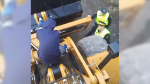 An image from video posted to Facebook by user Uni Urchin shows a demonstrator on top of an excavator at the Kinder Morgan site in Burnaby Monday, March 19, 2018.