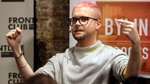 """Chris Wylie, from Canada, who once worked for the UK-based political consulting firm Cambridge Analytica, gives a talk entitled """"The Most Important Whistleblower Since Snowden: The Mind Behind Cambridge Analytica"""" at the Frontline Club in London, Tuesday, March 20, 2018. (AP Photo/Matt Dunham)"""