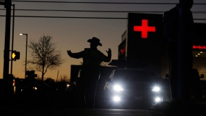 Texas troopers help redirect traffic near the site of another explosion, Tuesday, March 20, 2018, in Austin, Texas. (AP Photo/Eric Gay)