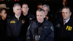 Austin Police Chief Brian Manley, center, stands with other members of law enforcement as he briefs the media, Wednesday, March 21, 2018, in the Austin suburb of Round Rock, Texas. The suspect in a spate of bombing attacks that have terrorized Austin over the past month blew himself up with an explosive device as authorities closed in, the police said early Wednesday. (AP Photo/Eric Gay)