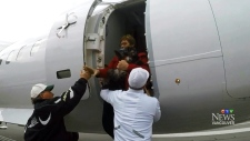 A passenger is helped off of Flight 3161