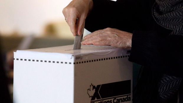 A woman casts her vote for the federal election in a polling station on Toronto's Ward Island on Monday May 2, 2011. THE CANADIAN PRESS/Chris Young