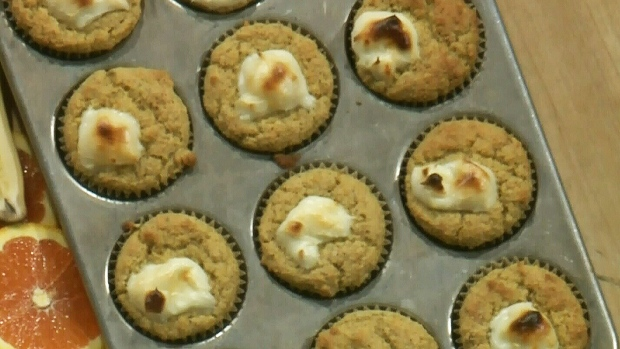 Orange banana muffin with cream cheese dollop