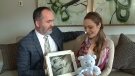 Steve Martin and Bekah Shirey hold a photo of baby Elijah, stillborn on July 29, 2017 just days before his due date.